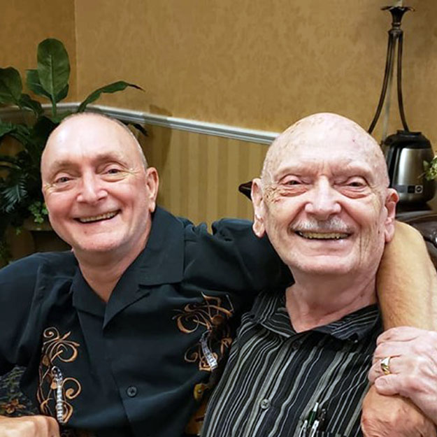 Two happy senior men in retirement living community