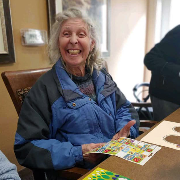 Senior has fun in her independent living community