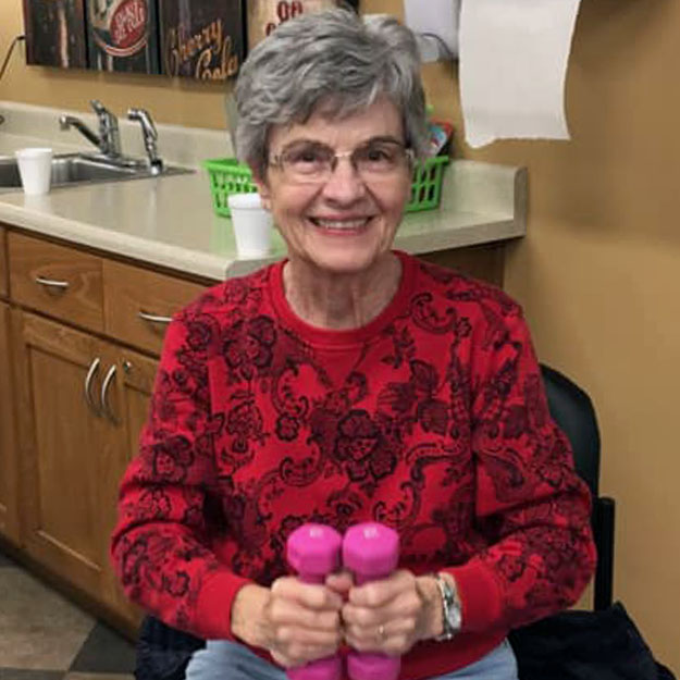 Fitness is important to this senior woman in memory care living community