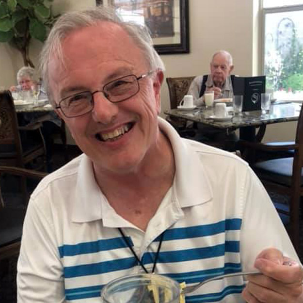 Laughing senior man enjoys memory care and assisted living