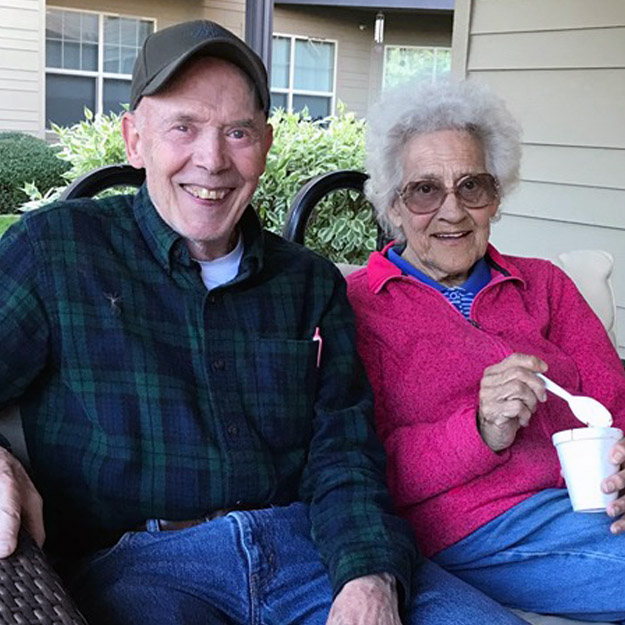 Two seniors having a good time in their retirement living community for memory care seniors