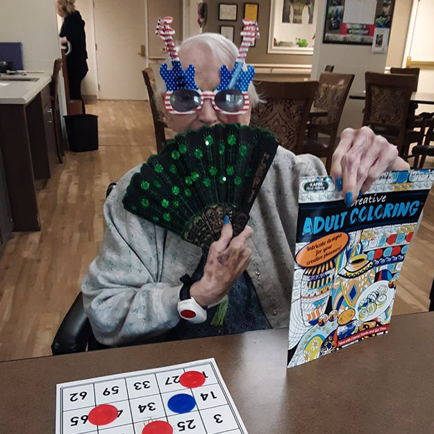 Senior wearing fun costume in her assisted living community for retirement seniors