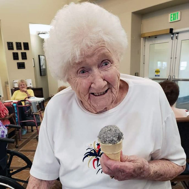 Happy senior with ice cream in her assisted living community