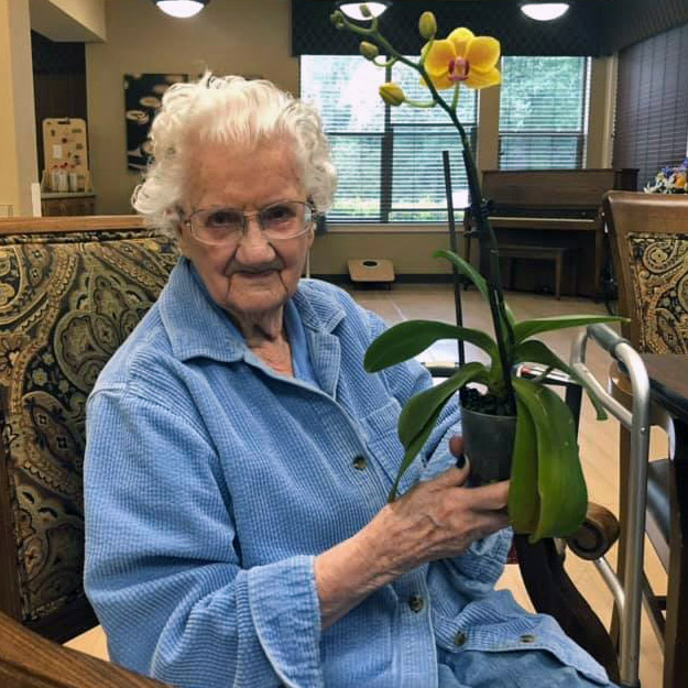 Happy memory care senior in her retirement living community
