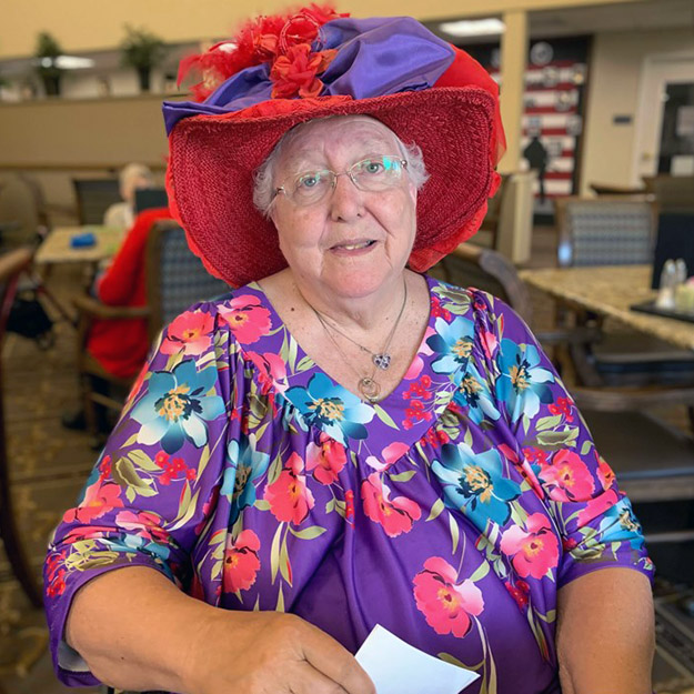 Woman in senior hat for memory care and independent living community