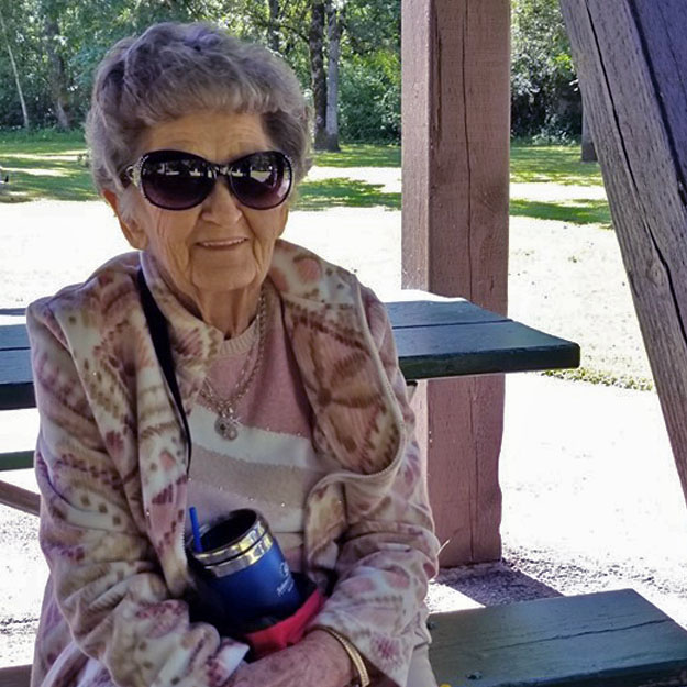 Senior woman sits in memory care community