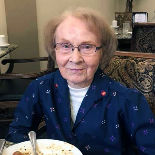 Smiling senior woman revels in assisted living community
