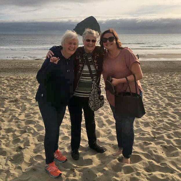 Three seniors on beach in independent living community