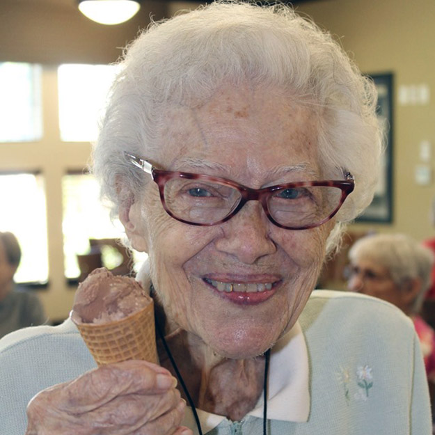 Happy senior and ice cream in assisted living and memory care for independent living seniors