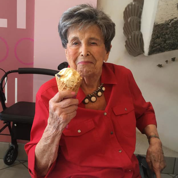 Ice cream eating senior living community woman assisted living