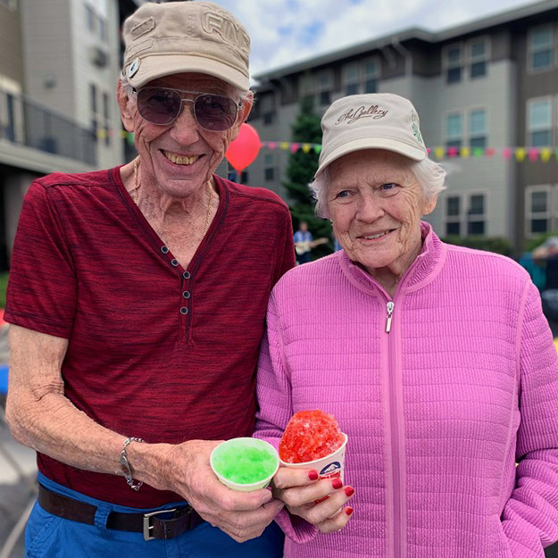 Two happy seniors in their assisted living community and memory care