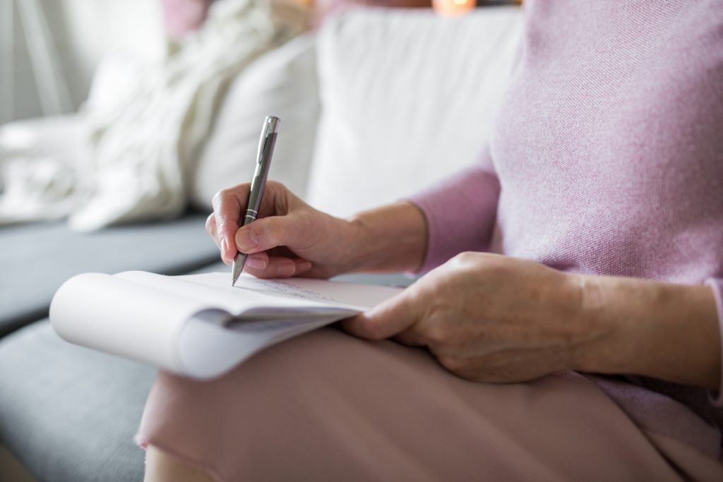 Senior living writing a story for retirement