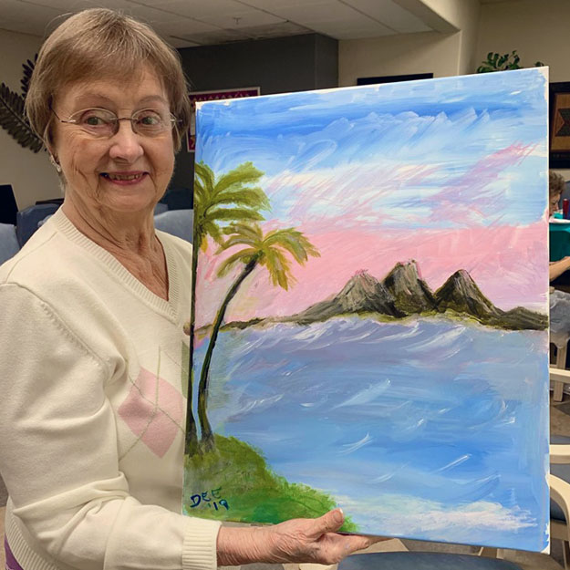 Senior woman with painting in memory care community living