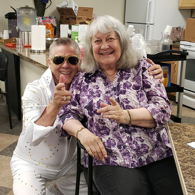 Senior and Elvis have fun in retirement living community