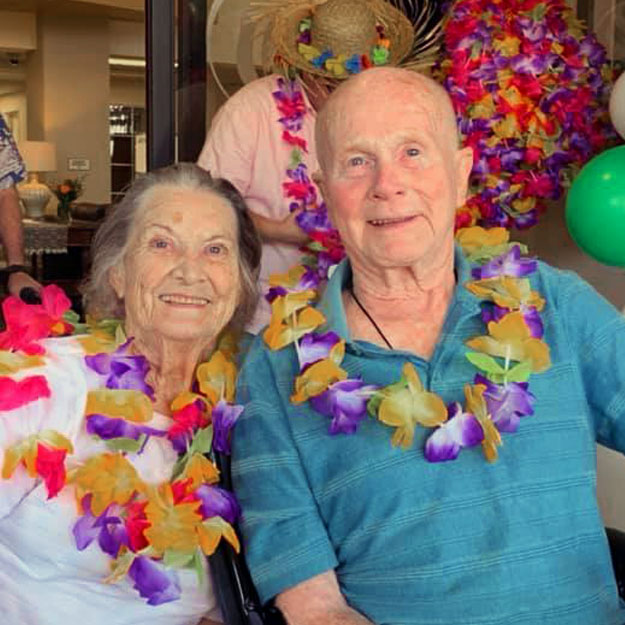Two seniors enjoy living in their retirement and assisted living community