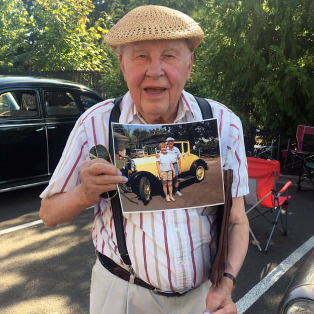 Senior man with photo in retirement living community