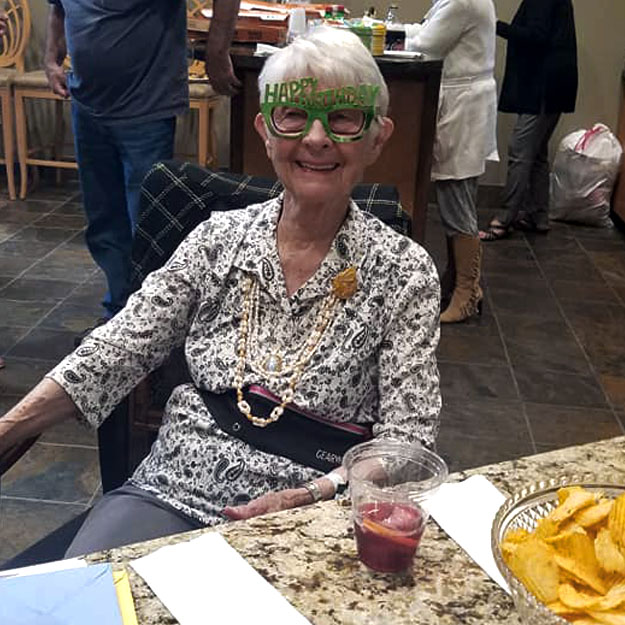 Senior woman has fun in assisted living community