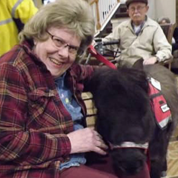 Happy senior with a small horse in retirement living community