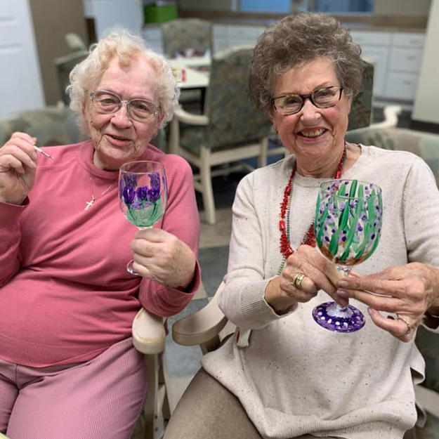 Two seniors hold art projects in memory care community