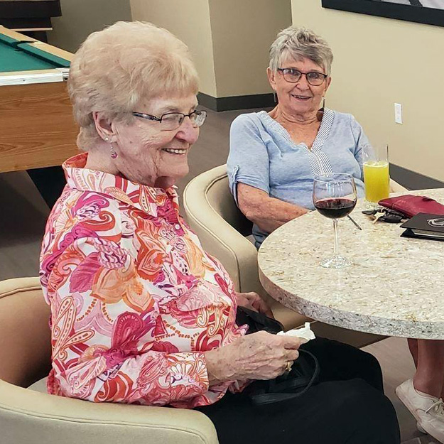 Seniors enjoying their own company in assisted living community