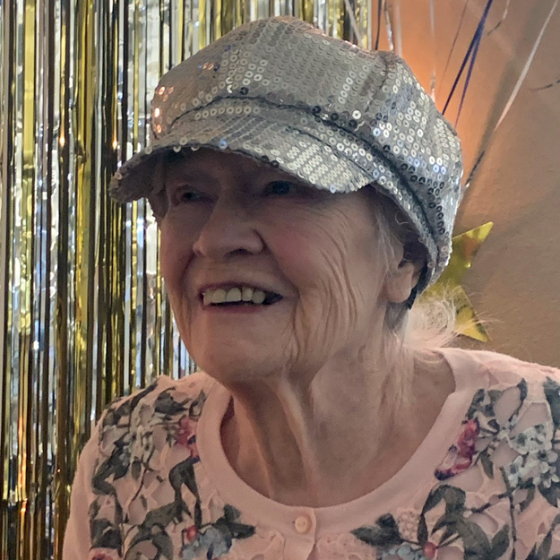 Senior with hat in memory care