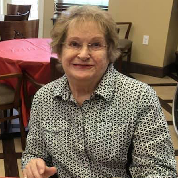 Happy woman in her memory care community for those with assisted living needs