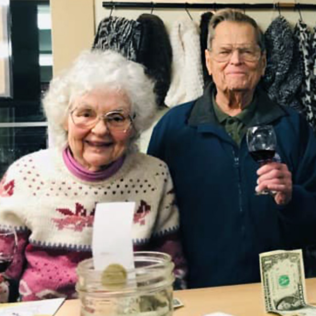 A senior man and a senior woman have a good time at their assisted living community