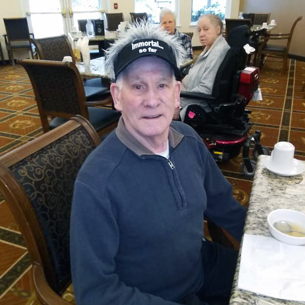 Senior man with funny hat in assisted living