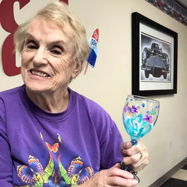 Woman holds art glass in memory care