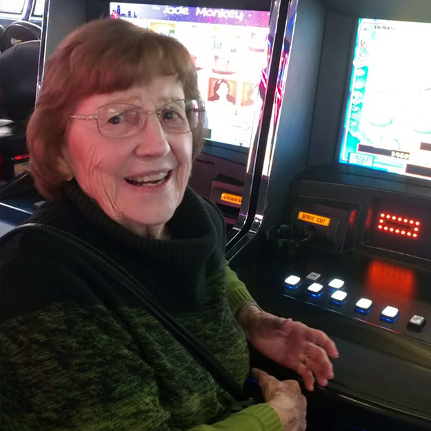 Woman having fun in a casino in her senior living community