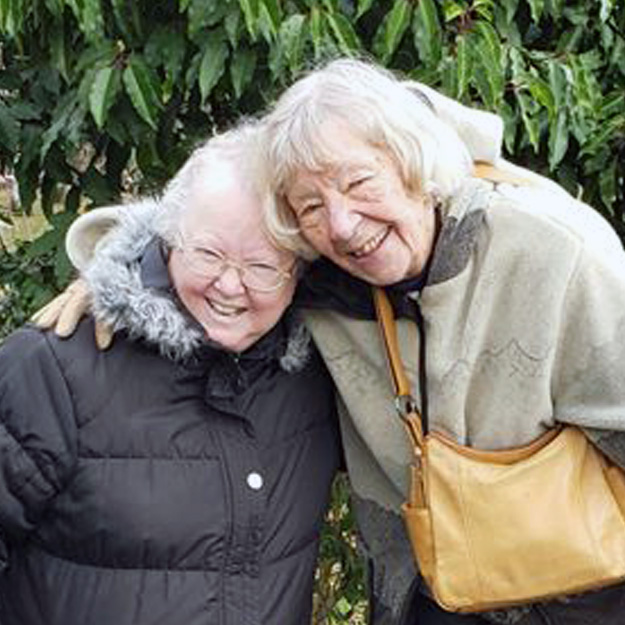 Two happy senior women in independent living