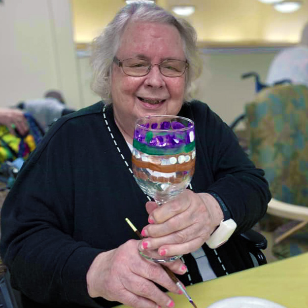 Senior with art glass project in assisted living