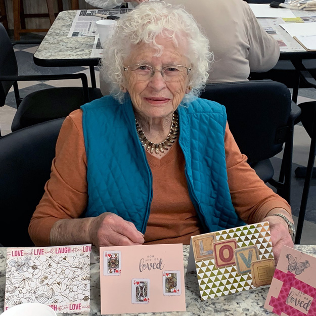 Senior woman does arts and crafts in her retirement community