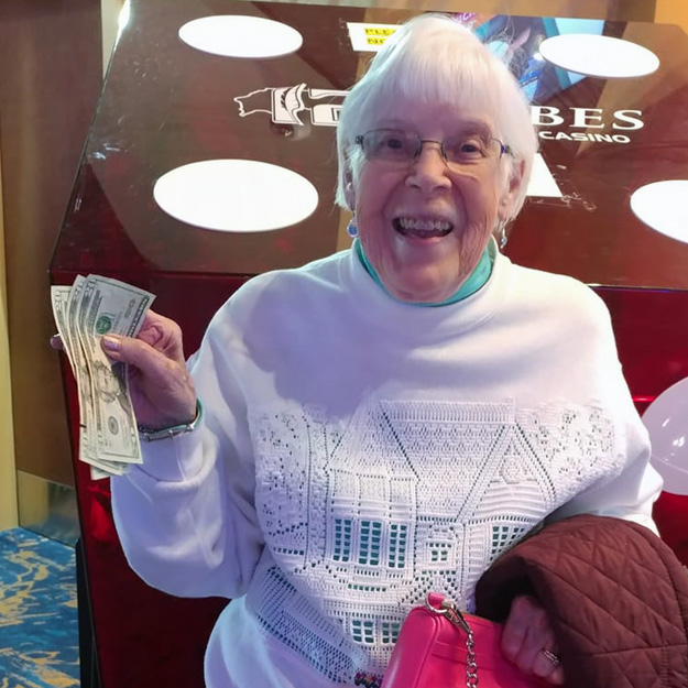 Senior with money and having a good time in memory care