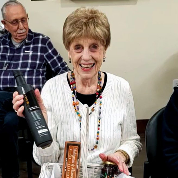 Thrilled senior woman having a good time in memory care