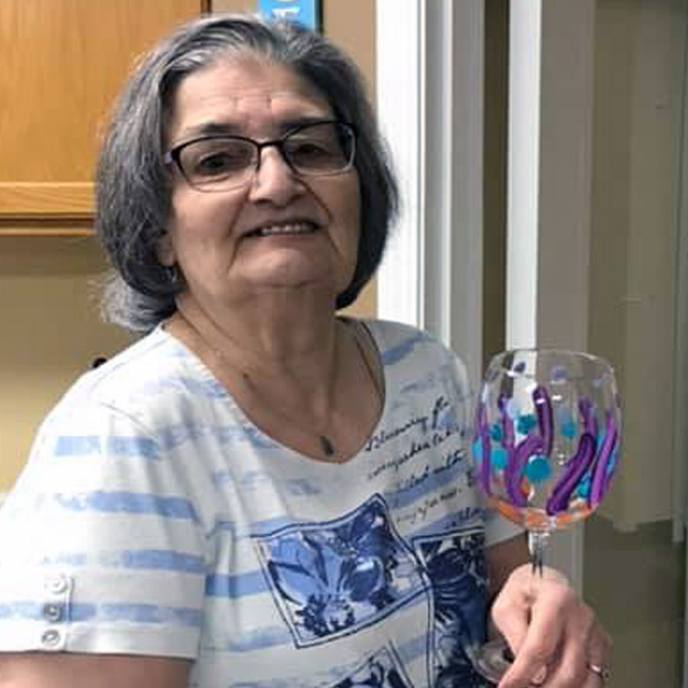 Woman holds art project in her senior living community