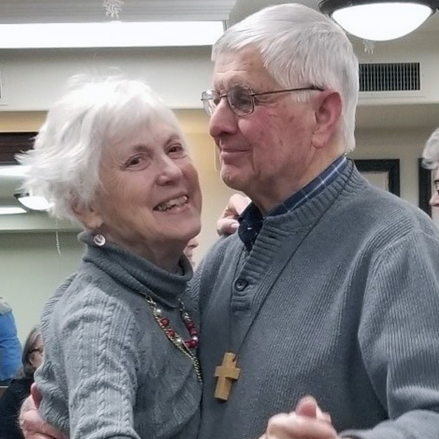 Two senior dance in their independent living community