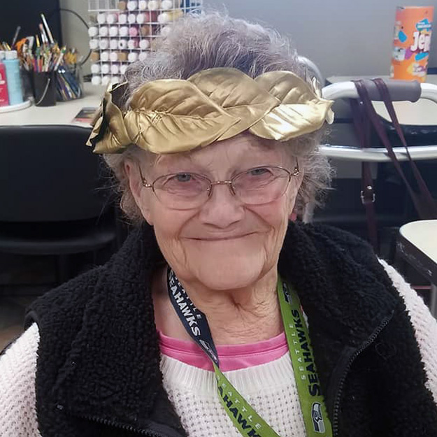 A woman smiling about her amazing independent living community