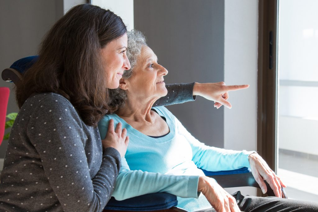 Senior with her family caregiver in assisted living and memory care for those with retirement and independent living needs