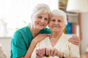 Assisted living caregiver with senior woman in their retirement living community