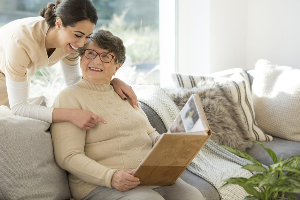 Senior with caregiver in her memory care community